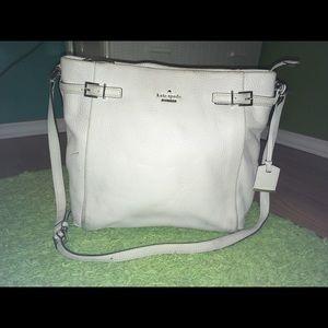 White Kate spade handbag.
